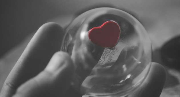 Order of protection -hand holding heart in plastic bottle